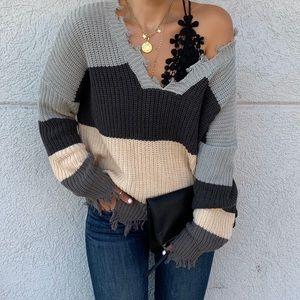 Size medium distressed color block sweater